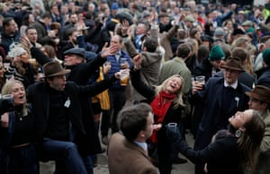 Racegoers enjoy a drink and a bit of a sing-song in the Guinness Village