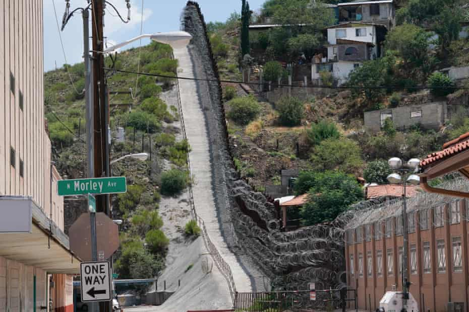 The border wall separating Nogales, Arizona from Nogales, Mexico. The Arizona city has suffered an enormous economic impact from the border closure.