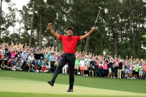 After a nervy approach to the 18th, Woods has two putts to win his 15th major. The first lips the cup and the second drops. After 11 long years, Woods is a major champion.