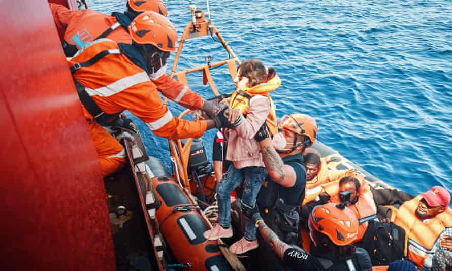 A migrant is brought on board Sea-Eye 4 during a rescue mission.