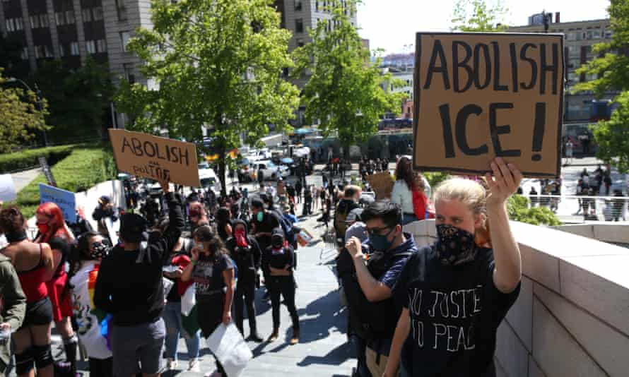 Protesters rally against Ice outside City Hall in Seattle. Human rights advocates says there has been a significant acceleration of deportations linked to the possibility that Ice could soon be under new management.