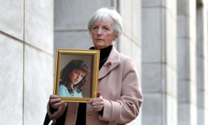 Marie McCourt holds a picture of her daughter, Helen.