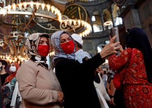 Women take a selfie at the mosque.