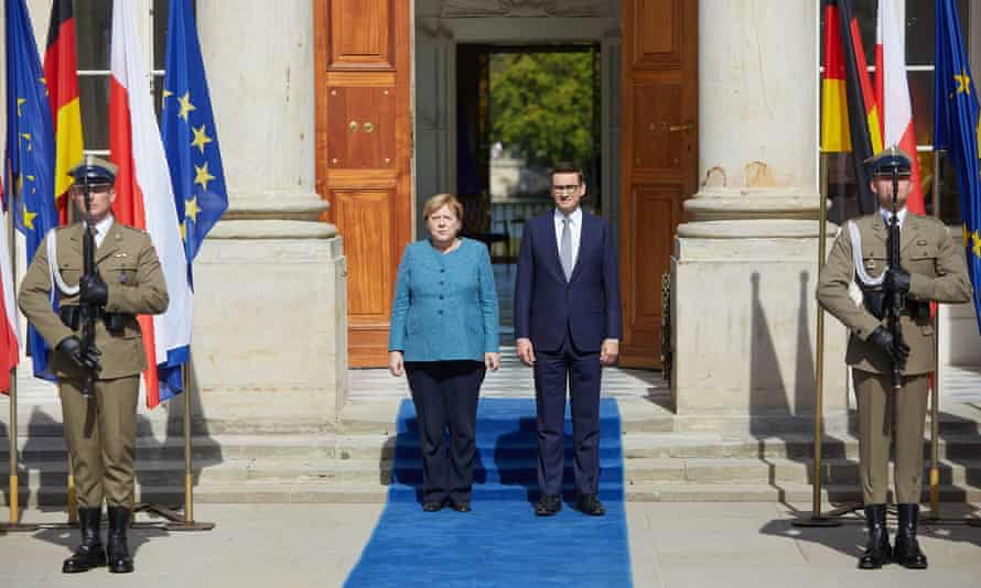 Merkel and Polish PM Mateusz Morawiecki in Warsaw