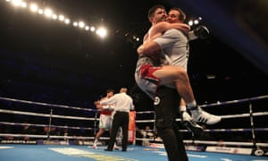 John Ryder celebrates with his trainer after defeating Jamie Cox.