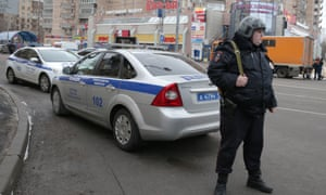 A police officer seen near Oktyabrskoye Pole metro station in Moscow where a woman suspected of killing a young child was detained.