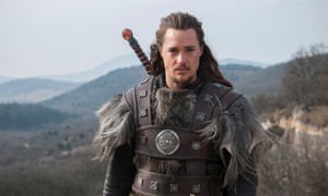 Alexander Dreymon as Uhtred, complete with difficult man bun.