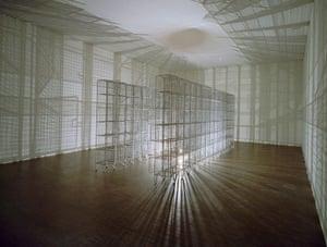 Light Sentence, 1992 by Mona Hatoum 36 wire mesh compartments, electric motor, light bulb