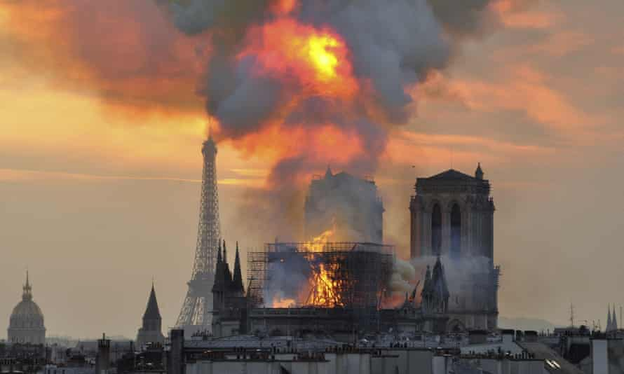 Flames and smoke rise from the fire at Notre Dame cathedral on 15 April 2019.