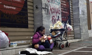 A mother with her baby begging in Athens. The youth unemployment rate has reached 51% in Greece, compared with 16% in the UK.