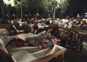 Hotel guests sleep outdoors after abandoning their rooms in Bitez
