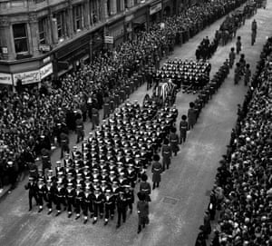 Crowds watch naval ratings pulling the gun carriage bearing the coffin of Sir Winston Churchill to St Paul's Cathedral.