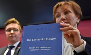 Marina Litvinenko holds a copy of the inquiry report with her son Anatoly Litvinenko.
