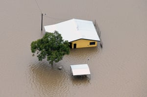 A house surrounded by flood waters in Ingham.