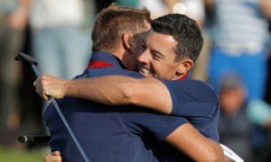 Ian Poulter and Rory McIlroy of Europe celebrate victory over Bubba Watson and Webb Simpson.