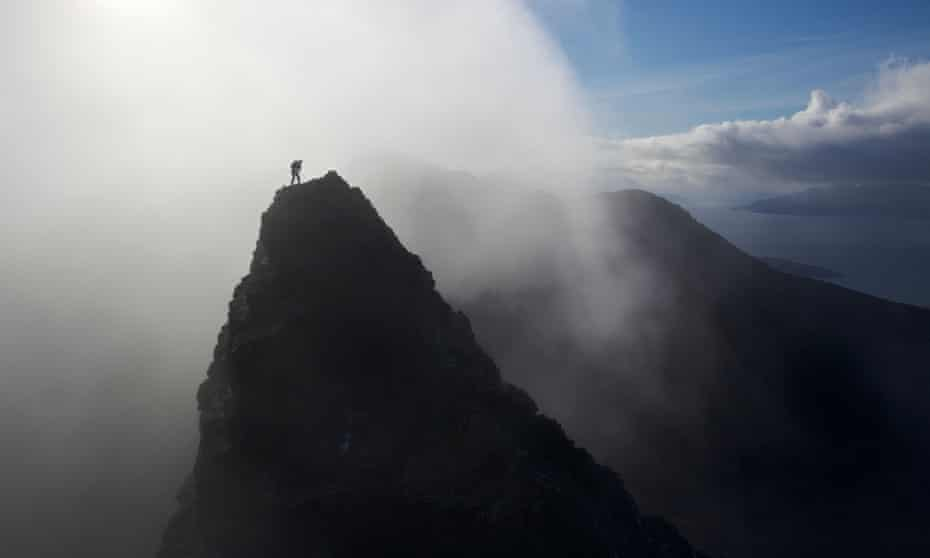 'I took a small step to the left. And then everything went wrong' ... a climber summits a pinnacle in the legendary Scottish mountain range, which is the subject of The Black Ridge.