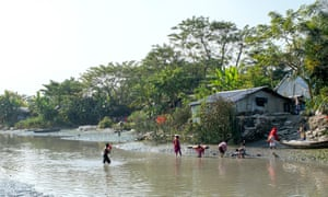 Villagers bathe in the the Kirtonkhola river.