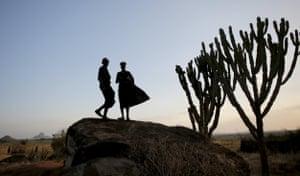 Karamojong tribesmen are photographed in silhouette in Kaabong, Uganda