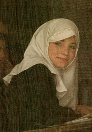 Kabul, 2004. An unidentified girl looks out from the mesh window of her classroom at the special school for Out of School Girls in Kabul, where girls denied an education by the Taliban were prepared to return to regular classes.