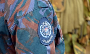 A police officer stands guard in Papua New Guinea