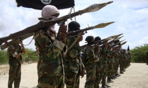 Al-Shabaab militants parade new recruits after arriving in Mogadishu from their training camp on 21 October 2010.