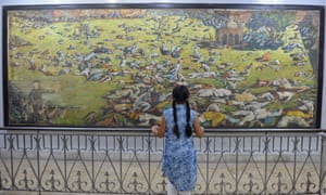 An Indian girl looks at a painting of the Jallianwala Bagh massacre.