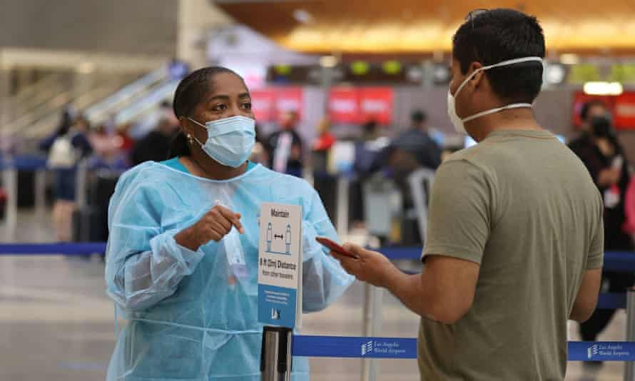 Covid testing at LAX airport. Health experts warned that infections and deaths will continue to soar in the coming weeks.