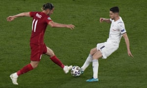 Turkey's Yusuf Yazici (left) challenges for the ball with Italy's Jorginho.