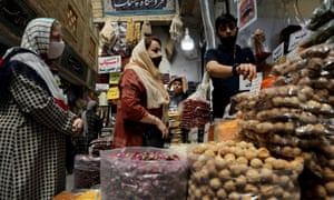 Women wearing protective face masks shop at a bazaar in Tehran. Iran has recorded more than 300,000 cases of coronavirus and more than. 16,500 deaths.