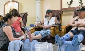 Men getting their feet done at the nail salon.