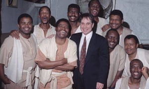 Joseph Shabalala, front left, with members of Ladysmith Black Mambazo, and Paul Simon, front right, in 1993. They worked with Simon on his Graceland project, and he produced their first international album.