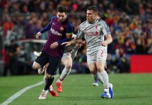Liverpool's James Milner fouls Barcelona's Lionel Messi.