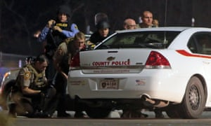 Police mobilize in the parking lot of the Ferguson Police Station after the shooting.