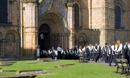 Durham University graduates queueing to enter the cathedral prior to their graduation ceremony.