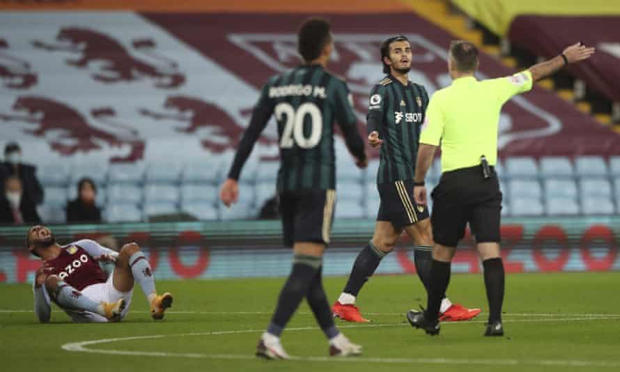 Leeds United's Pascal Struijk with the referee Paul Tierney after fouling Aston Villa's Douglas Luiz