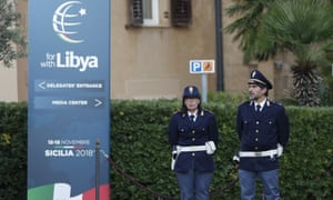 Police officers outside a Libya conference in Palermo, Italy