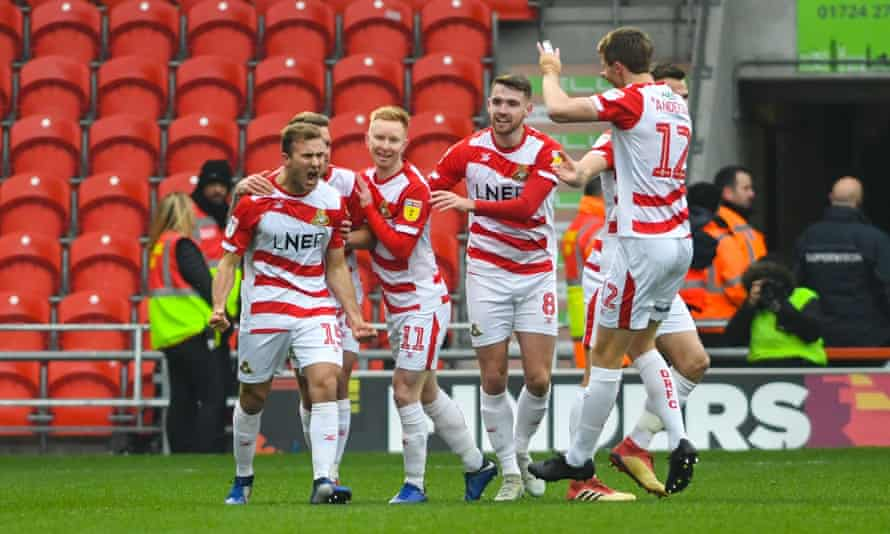 Herbie Kane (far left) celebrates scoring for Doncaster against Scunthorpe in mid-December.