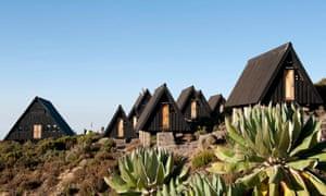 Scandinavian-style wooden huts on the Marangu Route of Kilimanjaro.