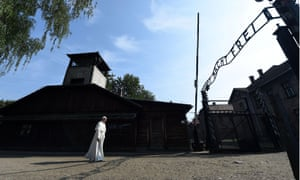 Pope Francis walks through the gate at Auschwitz.
