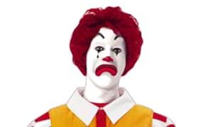 Ronald McDonald in his trademark yellow jumpsuit.