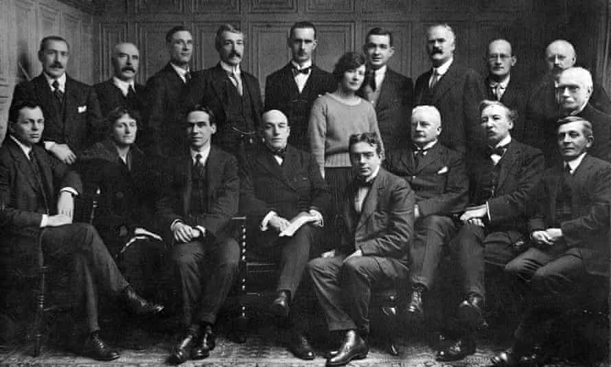 The Editorial, Financial and Wire Room members of the Manchester Guardian staff in 1921. Back row: Messrs. F. Marshall, J.M. Denvir, R. Nelson, F.W. Long, J.H. Foxcroft, I. Brown, E.N. Smith, F. Perrot, A. Percival Middle row: Mrs. Avis, Mr. H. Rose Front row: Mr. H. Gravett, Miss E. Isitt, Messrs. O.R. Hobson, J. Bone, H. Dore, J. Drysdale, A.H. Boyd, H. Williams