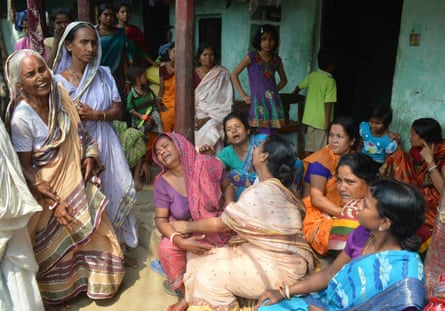 Mourners gather after a local is killed by an elephant in the village of Baghasole, West Bengal