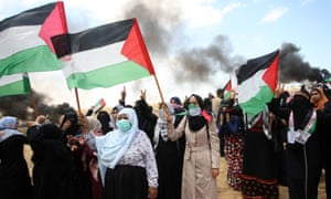 Palestinian women in Rafah, southern Gaza, stage a protest to mark the 70th anniversary of Nakba in May 2018