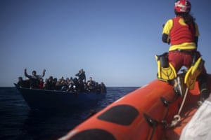 Mediterranean Sea – Migrants from Eritrea, Egypt, Syria and Sudan are assisted about 110 miles north of the Libyan coast by aid workers from the Spanish NGO Open Arms, after fleeing Libya onboard a precarious wooden boat.