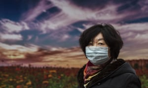 A Chinese woman wears protective mask
