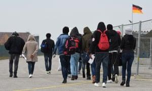 Migrants arrive at a registration centre for asylum seekers near Munich