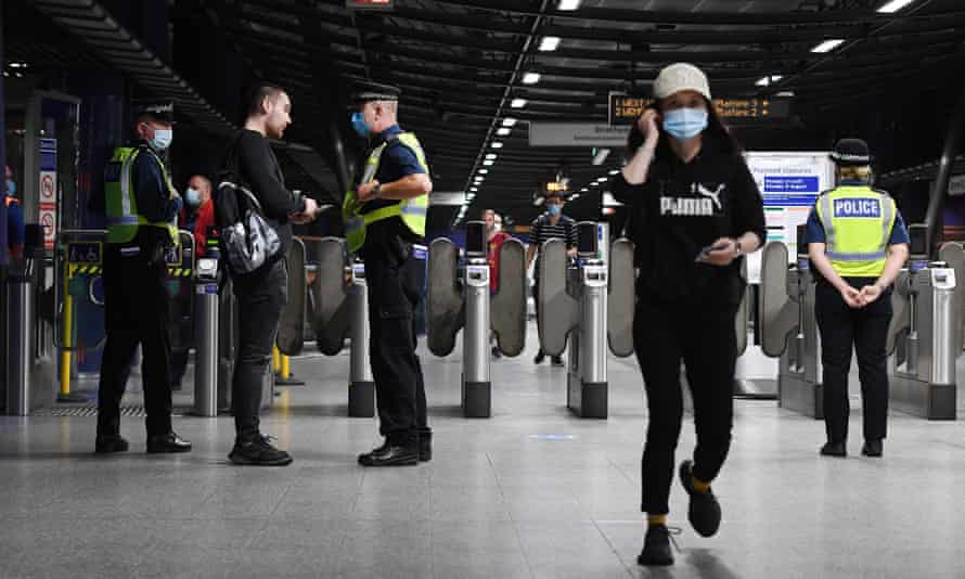 Anti-terror police on patrol at a station in central London.