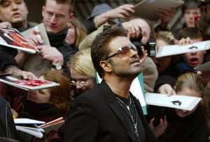 George Michael leaves a news conference for the film George Michael: A Different Story in Berlin in February 2005.