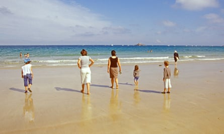 A family on the beach in Brittany. France is one of the countries UK nationals can go on holiday without facing restrictions.