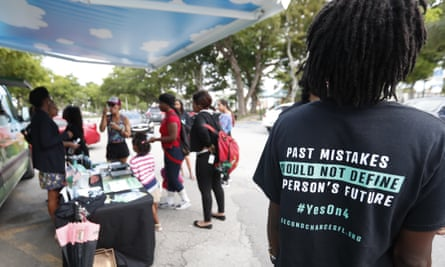 People gather around the Ben & Jerry's 'Yes on 4' truck as they learn about Amendment 4, which asked voters to restore the voting rights of people with past felony convictions.